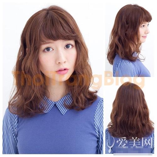 Kiểu tóc dài xoăn gợn sóng nhẹ đẹp dịu dàng